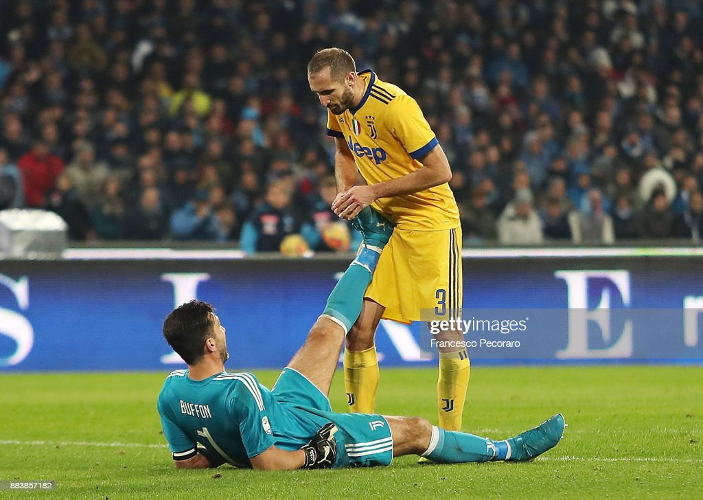 Giorgio Chiellini helps Gianluigi Buffon player of Juventus injured during the Serie A match between SSC Napoli and Juventus at Stadio San Paolo on December 1, 2017 in Naples, Italy.