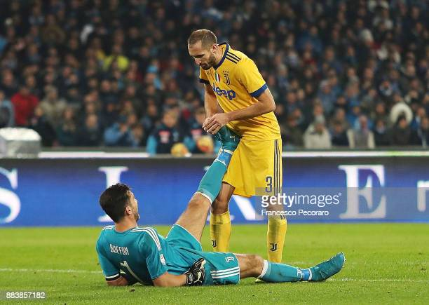 Giorgio Chiellini helps Gianluigi Buffon player of Juventus injured during the Serie A match between SSC Napoli and Juventus at Stadio San Paolo on...