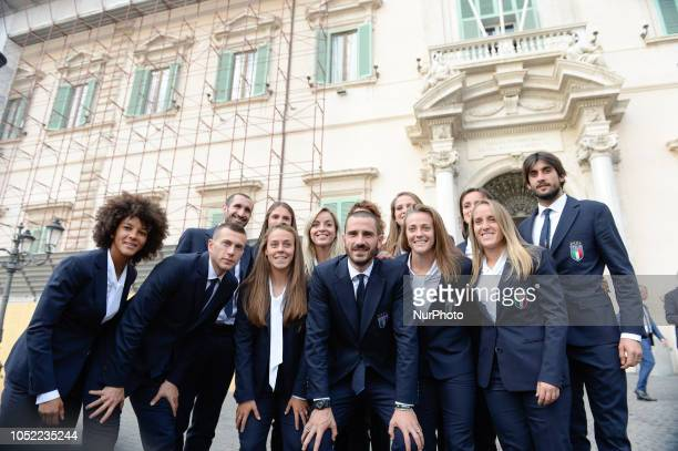 Giorgio Chiellini Leonardo Bonucci Federico Bernardeschi Mattia Perin pose with the women's national football players after the ceremony for the...