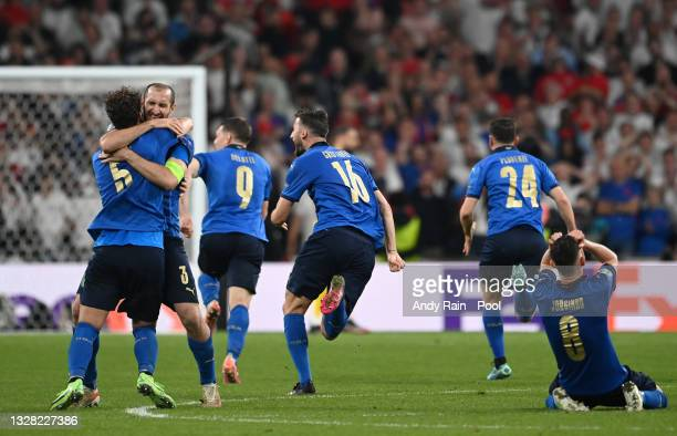 Giorgio Chiellini, Manuel Locatelli and Jorginho of Italy celebrate after victory in the UEFA Euro 2020 Championship Final between Italy and England...