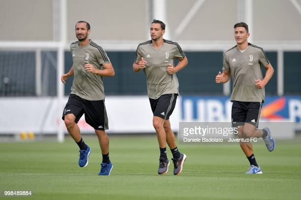 Giorgio Chiellini Mattia De Sciglio and Mattia Caldara during a Juventus morning training session on July 14 2018 in Turin Italy
