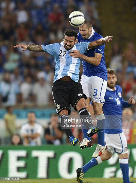 Giorgio Chiellini of Italy and Ezequiel Lavezzi of Argentina compete for the ball during the international friendly match between Italy v Argentina...