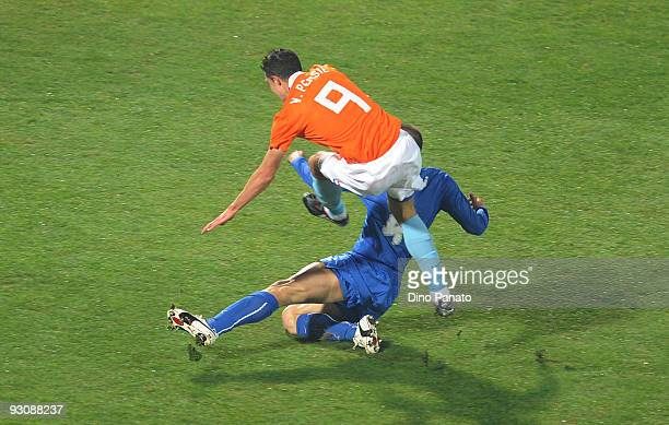 Giorgio Chiellini of Italy and Robin Van Persie of Holand an injury during the International Friendly Match between Italy and Holland at Adriatico...
