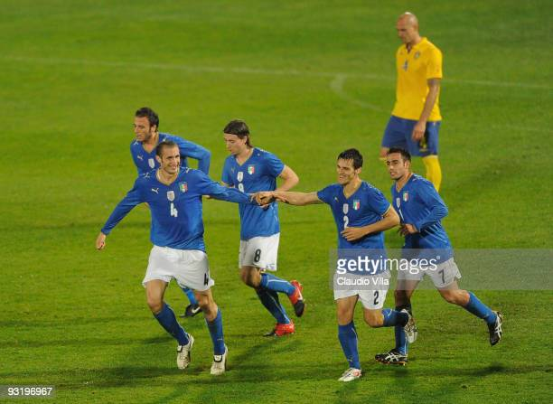 Giorgio Chiellini of Italy celebrates after scoring the opening goal with team mate Christian Maggio during the international friendly match between...