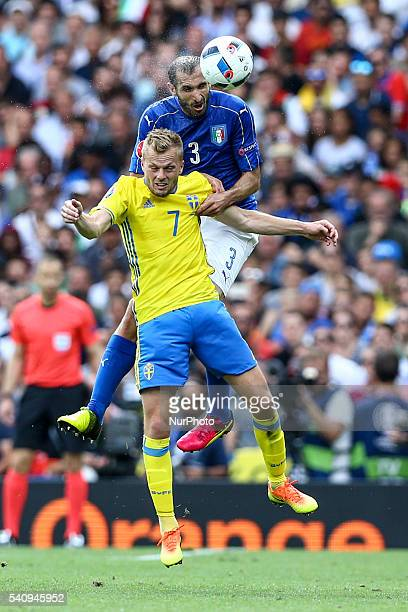 Giorgio Chiellini of Italy is challenged by Sebastian Larsson of Sweeden during the UEFA EURO 2016 Group E match between Italy and Sweden at Stadium...