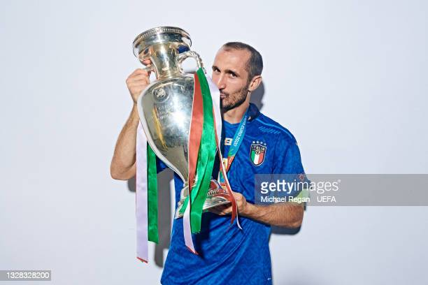 Giorgio Chiellini of Italy poses with The Henri Delaunay Trophy during an Italy Portrait Session following their side's victory in the UEFA Euro 2020...
