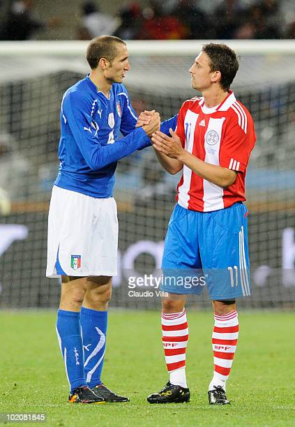 Giorgio Chiellini of Italy shakes hands with Jonathan Santana of Paraguay after their teams drew 11 in the 2010 FIFA World Cup South Africa Group F...