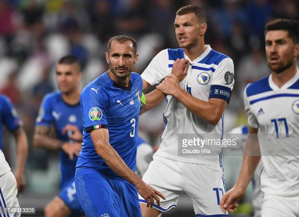 Giorgio Chiellini of Italy struggles with Edin Dzeko of Bosnia during the UEFA Euro 2020 Qualifier between Italy and Bosnia and Herzegovina at...