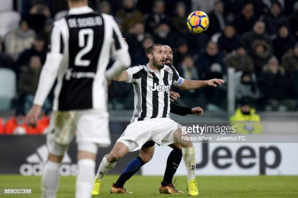 Giorgio Chiellini of Juventus and Borja Valero of FC Internazionale compete for the ball during the Serie A match between Juventus and FC...