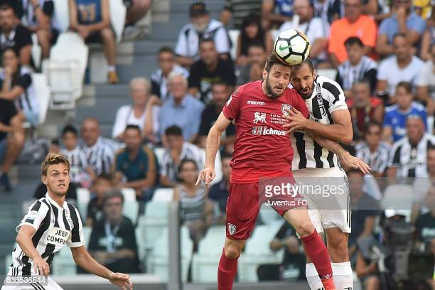 Giorgio Chiellini of Juventus and Duje Cop of Cagliari compete for the ball during the Serie A match between Juventus and Cagliari Calcio at Allianz...