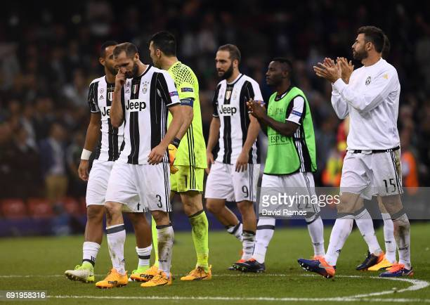 Giorgio Chiellini of Juventus and his Juventus team mates are dejected after the UEFA Champions League Final between Juventus and Real Madrid at...