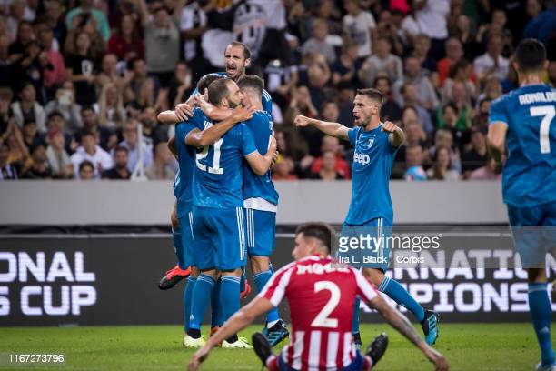 Giorgio Chiellini of Juventus and other teammates celebrate the goal by Sami Khedira of Juventus that tied up the score during the International...