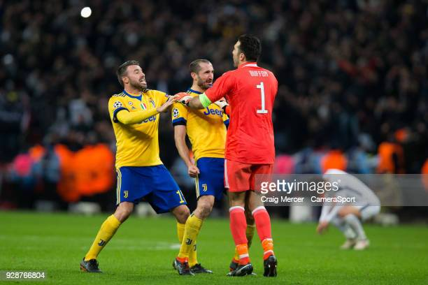 Giorgio Chiellini of Juventus and team mates Andrea Barzagli and Gianluigi Buffon celebrate their victory at the final whistle during the UEFA...