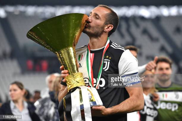 Giorgio Chiellini of Juventus celebrates during the awards ceremony after winning the Serie A Championship during the Serie A match between Juventus...