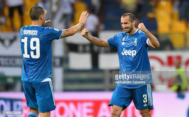 Giorgio Chiellini of Juventus celebrates the victory with Leonardo Bonucci of Juventus during the Serie A match between Parma Calcio and Juventus at...