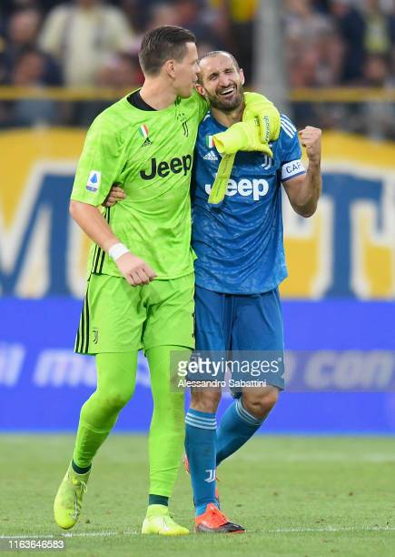 Giorgio Chiellini of Juventus celebrates the victory with Wojclech Szczesny of Juventus during the Serie A match between Parma Calcio and Juventus at...