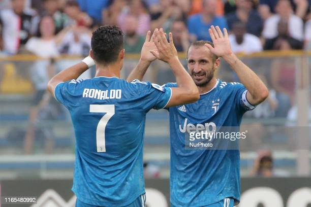 Giorgio Chiellini of Juventus celebrates with Cristiano Ronaldo of Juventus after scoring the goal during the Serie A match between Parma Calcio and...