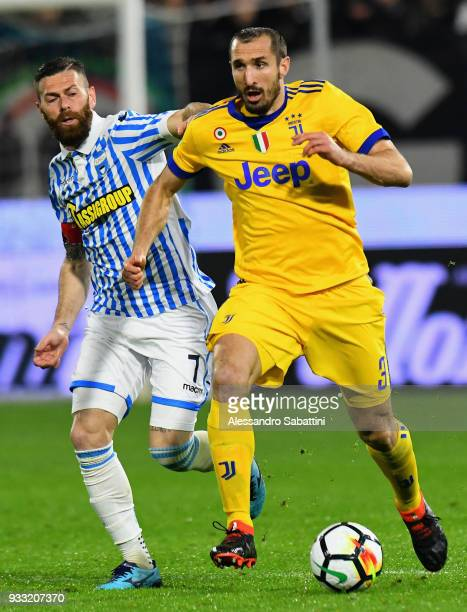 Giorgio Chiellini of Juventus competes for the ball whit Mirko Antenucci of Spal during the serie A match between Spal and Juventus at Stadio Paolo...