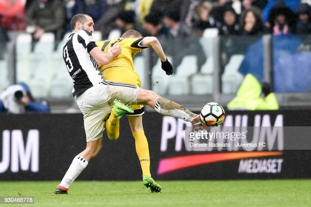 Giorgio Chiellini of Juventus competes for the ball with Bram Nuytinck of Udinese Calcio during the serie A match between Juventus and Udinese Calcio...