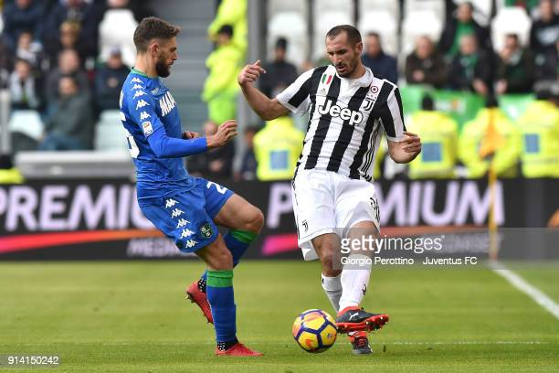 Giorgio Chiellini of Juventus competes for the ball with Domenico Berardi of Sassuolo during the serie A match between Juventus and US Sassuolo on...