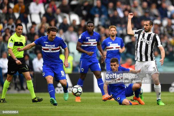 Giorgio Chiellini of Juventus competes for the ball with Edgar Barreto and Gaston Ramirez of UC Sampdoria during the serie A match between Juventus...