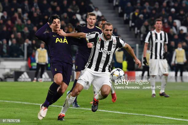 Giorgio Chiellini of Juventus competes for the ball with Erik Lamela of Tottenham Hotspur FC during the UEFA Champions League Round of 16 First Leg...