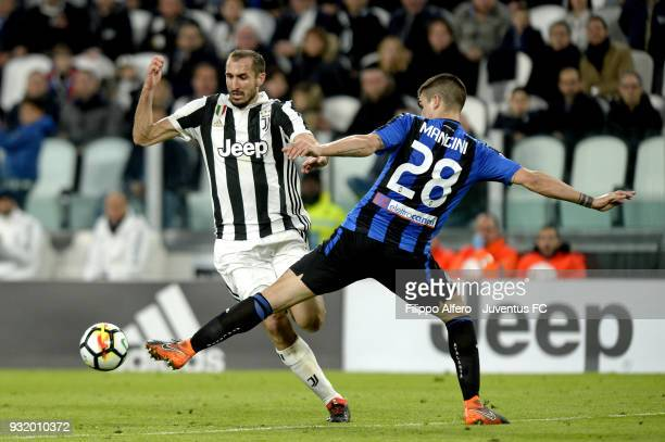 Giorgio Chiellini of Juventus competes for the ball with Gianluca Mancini of Atalanta BC during the serie A match between Juventus and Atalanta BC on...