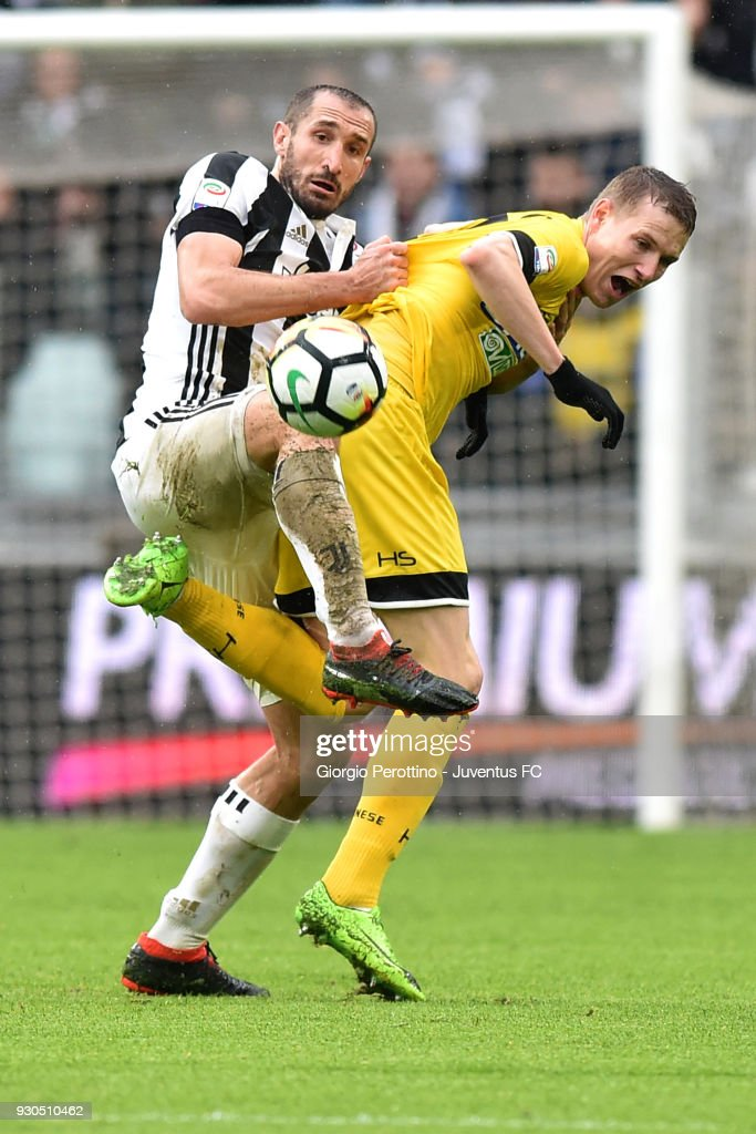 Giorgio Chiellini of Juventus competes for the ball with Jakub Jankto of Udinese Calcio during the serie A match between Juventus and Udinese Calcio on March 11, 2018 in Turin, Italy.