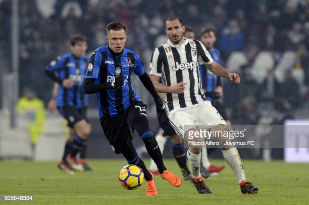 Giorgio Chiellini of Juventus competes for the ball with Josip Ilicic of Atalanta BC during the TIM Cup match between Juventus and Atalanta BC at...