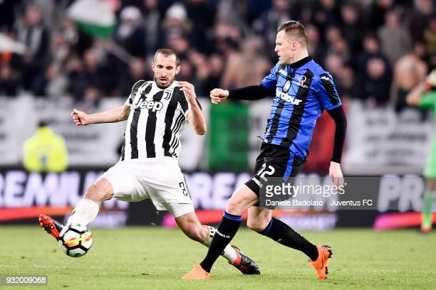 Giorgio Chiellini of Juventus competes for the ball with Josip Ilicic of Atalanta BC during the serie A match between Juventus and Atalanta BC on...