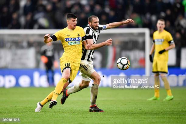 Giorgio Chiellini of Juventus competes for the ball with Stipe Perica of Udinese Calcio during the serie A match between Juventus and Udinese Calcio...