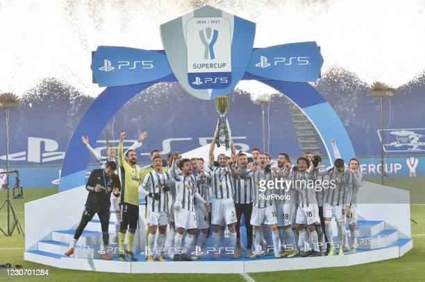Giorgio Chiellini of Juventus FC and his team mates celebrate after winning the Italian Super Cup Final match between FC Juventus and SSC Napoli at...