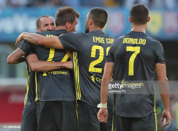 Giorgio Chiellini of Juventus FC celebrates the victory with his teammates Mario Mandzukic and Emre Can at the end of the serie A match between...