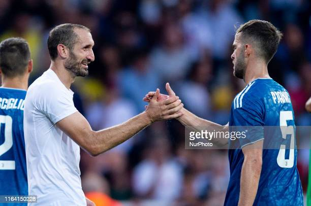 Giorgio Chiellini of Juventus FC celebrates the victory with Miralem Pjanic of Juventus FC during the Serie A match between Parma Calcio 1913 and...