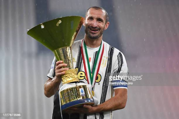 Giorgio Chiellini of Juventus FC celebrates with the trophy after the Serie A match between Juventus and AS Roma at Allianz Stadium on August 1, 2020...