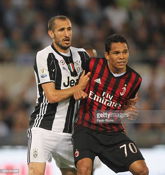Giorgio Chiellini of Juventus FC competes for the ball with Carlos Bacca of AC Milan during the TIM Cup final match between AC Milan and Juventus FC...