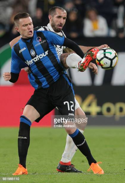 Giorgio Chiellini of Juventus FC competes for the ball with Josip Ilicic of Atalanta BC during the serie A match between Juventus and Atalanta BC at...