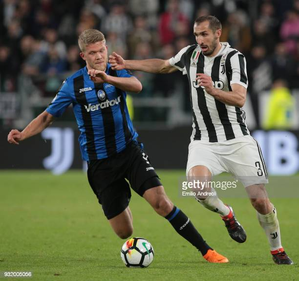 Giorgio Chiellini of Juventus FC is challenged by Andreas Cornelius of Atalanta BC during the serie A match between Juventus and Atalanta BC at...