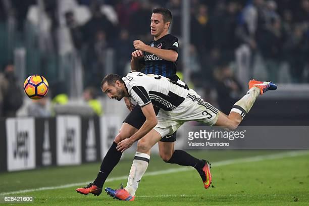 Giorgio Chiellini of Juventus FC is tackled by Aleksandar Pesic of Atalanta BC during the Serie A match between Juventus FC and Atalanta BC at...
