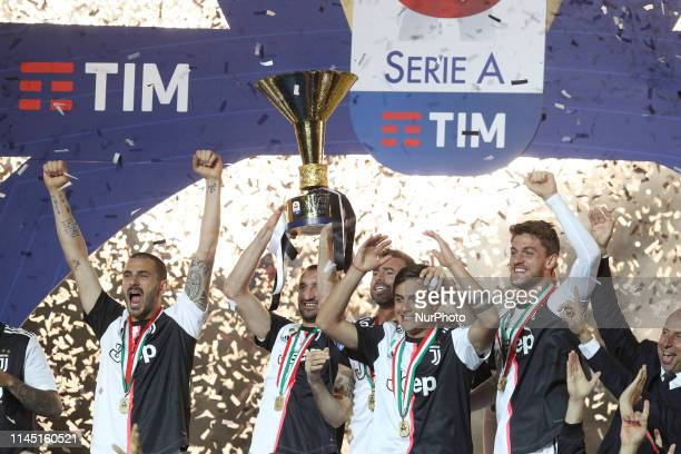 Giorgio Chiellini of Juventus FC lifts the trophy of Scudetto during the victory ceremony following the Italian Serie A last football match of the...