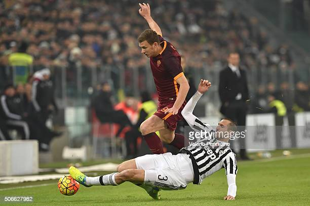 Giorgio Chiellini of Juventus FC tackles Edin Dzeko of AS Roma during the Serie A match between Juventus FC and AS Roma at Juventus Arena on January...