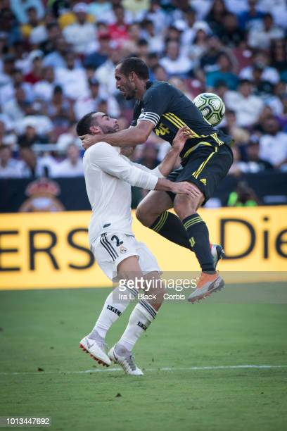 Giorgio Chiellini of Juventus goes up for the ball against Daniel Carvajal of Real Madrid a little roughly during the the International Champions Cup...