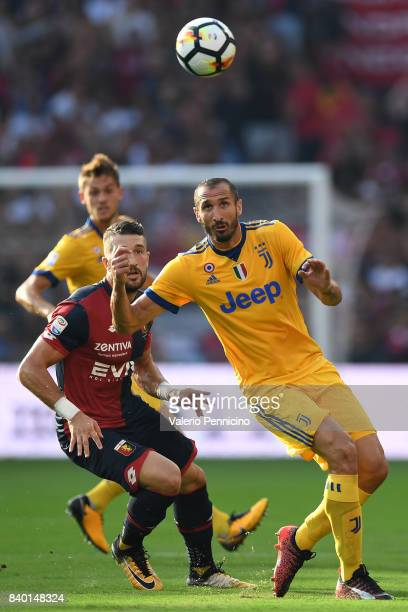 Giorgio Chiellini of Juventus in action against Andrey Galabinov of Genoa CFC during the Serie A match between Genoa CFC and Juventus at Stadio Luigi...