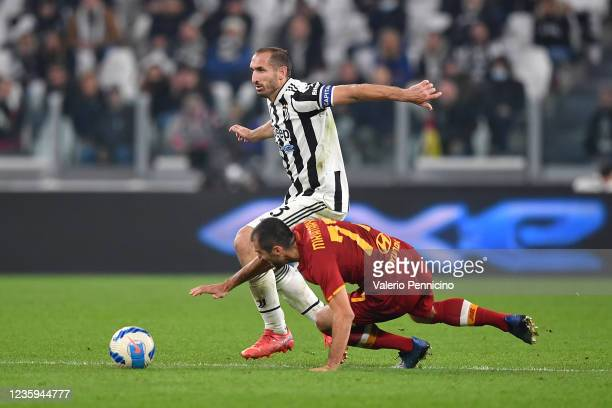 Giorgio Chiellini of Juventus is challenged by Henrikh Mkhitaryan of AS Roma during the Serie A match between Juventus and AS Roma at on October 17,...