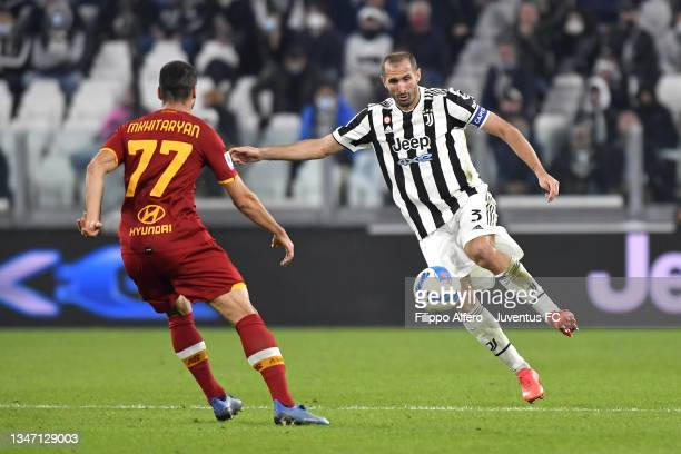 Giorgio Chiellini of Juventus is challenged by Henrikh Mkhitaryan of AS Roma during the Serie A match between Juventus and AS Roma at Allianz Stadium...
