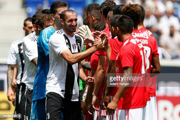 Giorgio Chiellini of Juventus leads his team in handshakes with Benfica during the International Champions Cup 2018 match between Benfica and...