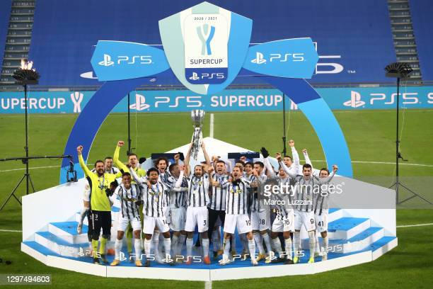 Giorgio Chiellini of Juventus lifts the PS5 Supercup after their side's victory in the Italian PS5 Supercup match between Juventus and SSC Napoli at...