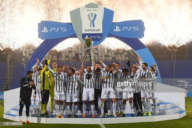 Giorgio Chiellini of Juventus lifts the PS5 Supercup following their side's victory in the Italian PS5 Supercup match between Juventus and SSC Napoli...