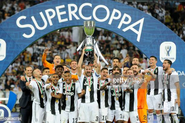 Giorgio Chiellini of Juventus lifts the trophy after winning thethe Italian Supercup match between Juventus and AC Milan at King Abdullah Sports City...