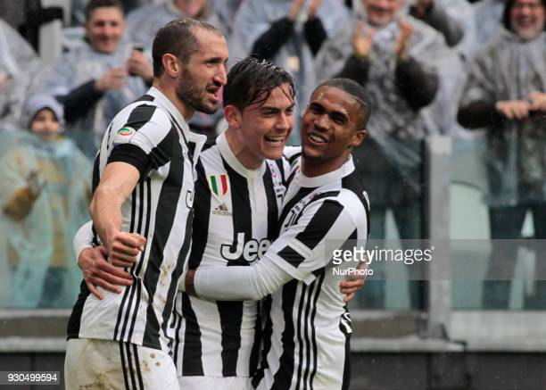 Giorgio Chiellini Paulo Dybala and Douglas Costa of Juventus celebrate after scoring the opening goal during the serie A match between Juventus and...